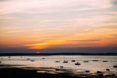 Заход солнца над пляжем трески накидки Стоковые Изображения