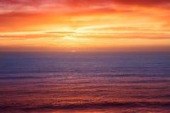 Заход солнца на пляже в Португалии Стоковая Фотография RF