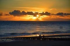 Заход солнца на пляже в Vlissingen, Nederland Стоковая Фотография