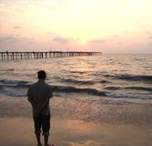 Заход солнца на пляже Кералы, Индии Стоковые Изображения