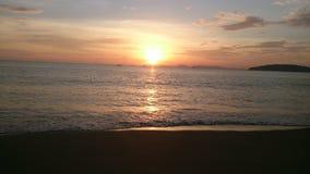 Заход солнца на пляже Стоковые Изображения