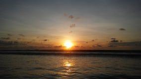 Заход солнца на пляже Kuta в Бали, Индонезии Стоковое Изображение RF