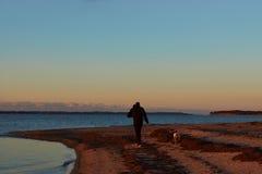 Заход солнца на пляже Vadum в Salling, Дании - серии Стоковые Изображения
