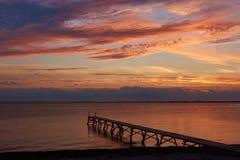 Заход солнца на пляже Vadum в Salling, Дании Стоковые Фотографии RF