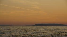 Заход солнца над разделением Стоковое Изображение