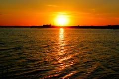 Заход солнца на расслоинах Стоковое Изображение