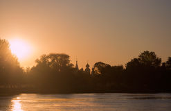 Заход солнца на реке надевает Стоковая Фотография