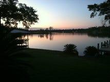 Заход солнца на реке собаки Стоковые Изображения