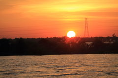 Заход солнца на реке Стоковые Изображения