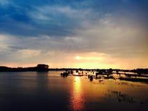 Заход солнца на реке Стоковая Фотография