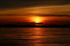 Заход солнца на реке Khong Стоковая Фотография