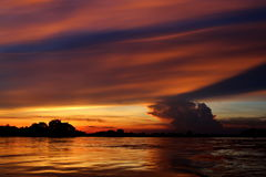 Заход солнца на реке Khong Стоковые Фотографии RF