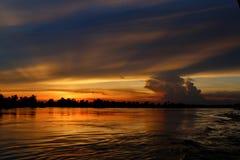 Заход солнца на реке Khong Стоковое Изображение RF