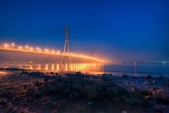 Заход солнца на реке Spanning мост Стоковые Изображения