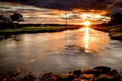 Заход солнца над северным пляжем Hampton стоковое изображение