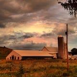 Заход солнца на ферме Стоковая Фотография