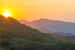 Заход солнца над холмами Стоковая Фотография