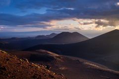 Заход солнца над холмами scoria Стоковые Изображения