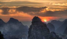 Заход солнца на холмах karst, guangxi Стоковые Фотографии RF