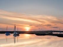 Заход солнца ` на ` Brancaster Staithe Стоковые Изображения RF