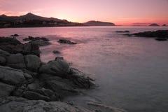 Заход солнца над Ile Rousse в Корсике Стоковое Изображение RF