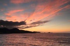 Заход солнца над Ile Rousse, Корсикой Стоковые Фото