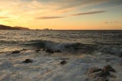Заход солнца над Ile Rousse, Корсикой Стоковое Фото
