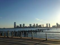 Заход солнца над Jersey City, NJ Стоковое Изображение