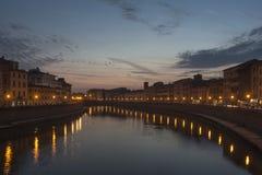 Заход солнца над lungarno Пизой, Тосканой, Италией, Европой Стоковые Фотографии RF