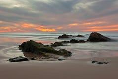 Заход солнца на playa El Cotillo Стоковые Изображения RF