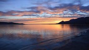 Заход солнца на Rovanjska на хорватском побережье Стоковые Фотографии RF