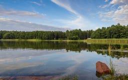 Заход солнца неба красивый на озере, Финляндии Стоковое Изображение