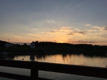 Заход солнца озером Стоковая Фотография