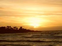 Заход солнца океана Pebble Beach Стоковые Фотографии RF