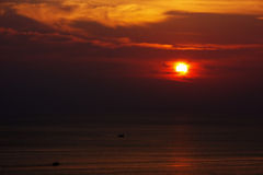 Заход солнца океаном Стоковое Фото