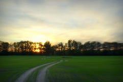 заход солнца дороги к Стоковая Фотография RF