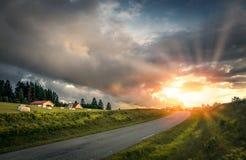 заход солнца дороги к Стоковое Изображение RF