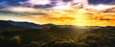 Заход солнца осени над холмами Стоковое Изображение RF