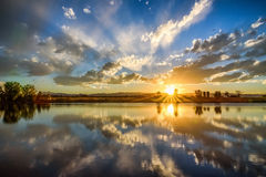 Заход солнца отражая в пруде Стоковая Фотография RF