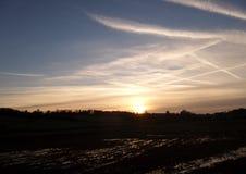 Заход солнца от идущего поезда Стоковое Изображение