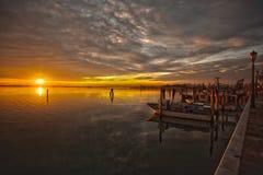 Заход солнца портовым районом Стоковое Фото