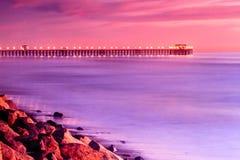 Заход солнца пристани берега океана Стоковые Фото