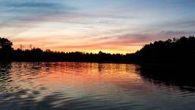 Заход солнца пруда Homme Стоковое Изображение RF