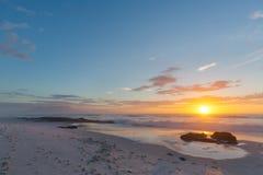 Заход солнца пляжа накидки Стоковые Изображения