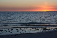 Заход солнца пляжа Fort Myers стоковое фото