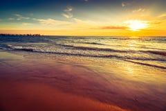 Заход солнца пляжа Glenelg драматический Стоковая Фотография