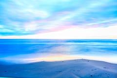 Заход солнца пляжем Стоковое Изображение