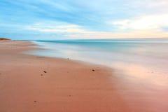 Заход солнца пляжем стоковые изображения