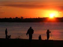 Заход солнца-реки-Poeple на реке Заход солнца-Миссиссипи, Новом Орлеане, Луизиане Стоковые Фото