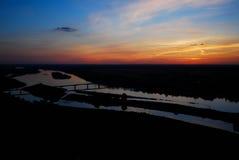 Заход солнца рекой Стоковые Изображения RF
